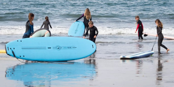 surfing at surfers beach