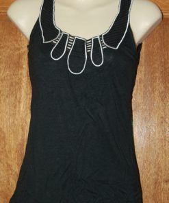 Black top with white stitching and cutouts