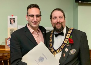 Tommy Vitolo presenting resolution honoring Brookline Elks to Stephen Connolly