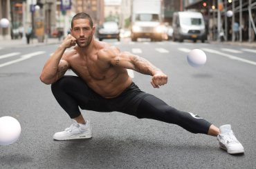 Neiman in stretching pose on street