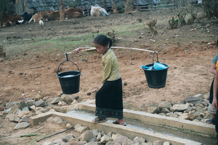 Young Girl Carrying Water in Laos