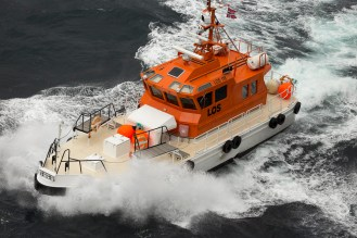 The pilot boat approaching to take the pilot off