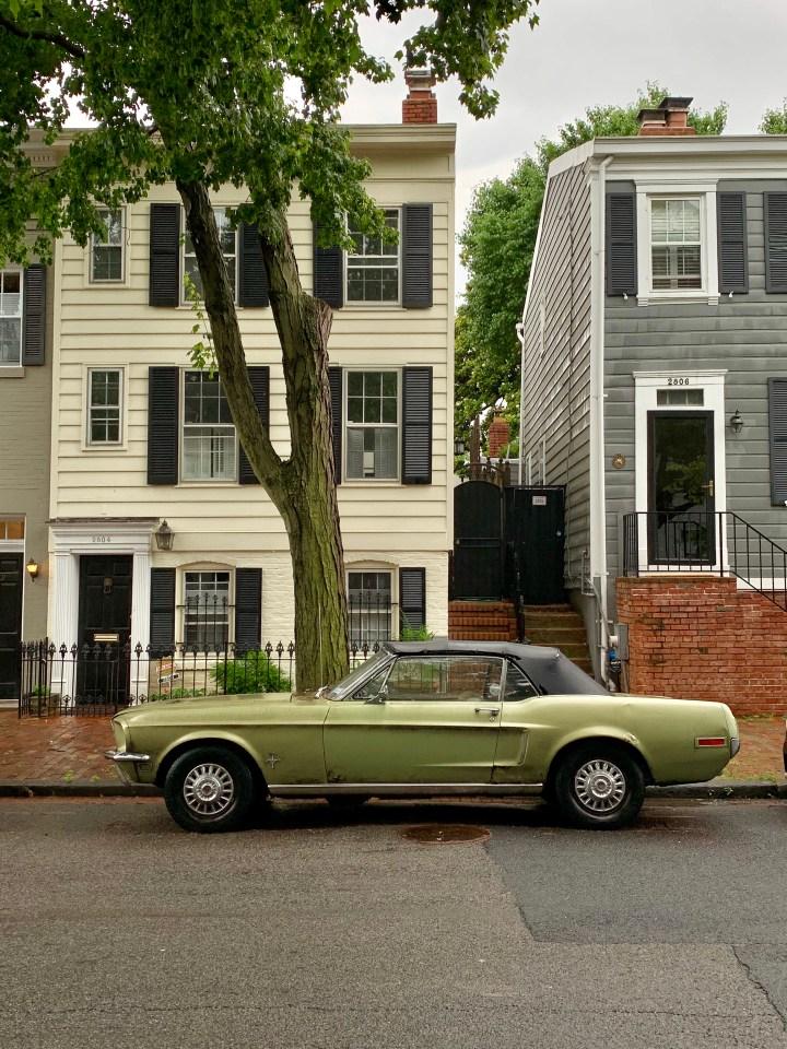 A green car on Dumbarton Street in Georgetown