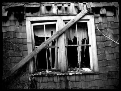 tattered-curtains-in-the-window-black-and-white-edit