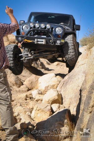 The spotter guides me through the nasty rocks