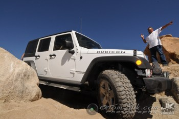 This nearly-stock Jeep Rubicon had modified rock-sliders that saved most of the damage, except for the major bending!