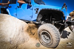 Kicking up dirt trying to grab traction to get over