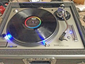 Picture of the Technics SL-1200 MK5 Turntable System, with power applied and featuring blue LED upgrades.