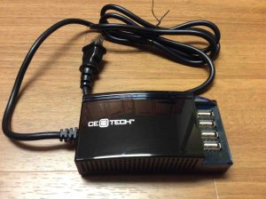 Picture of the High Current 4 Port USB Charger from CE Tech, showing the device removed from the package.