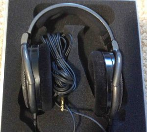 Picture of the Sennheiser HD650 Hi Fi Headphones, packed in included case.