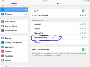 Screen shot from iPad Air, showing the Honeywell RTH8580WF Thermostat Created Wifi Network, circled in blue.
