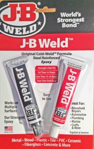 Picture of a card of JB Weld steel epoxy high temperature glue, front view.