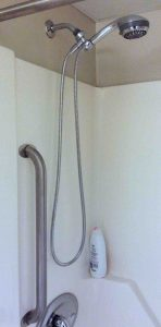 Picture of the Installed Danze D469020 Chrome Shower Hose in a typical bathroom shower tub.