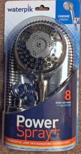 Picture of the Waterpik Power Spray Plus NSP-853 massaging shower head, front view, in package.