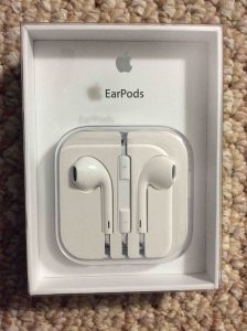 Picture of the Apple Earpods, earbuds, shown in original packaging, front.