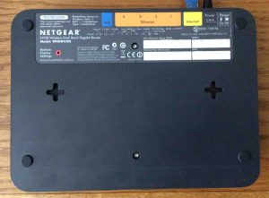 Picture of the underside of the Netgear N750 WNDR4300 WiFi router. Showing serial number and default network logon information. Netgear N750 WNDR4300 review.