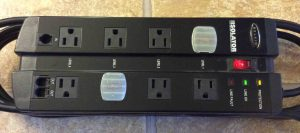 Top view picture of the Belkin Isolator surge protector F5C980-TEL, showing outlets, status lamps, and cord keeper.