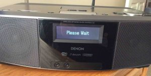 Picture of the radio, showing the blinking -Please Wait- message.