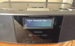 Picture of the Denon S-32 Radio, displaying the -Input Security Key- editor screen during reconnect WiFi, with blank password field.