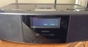 Picture of the Denon S-32 Wireless Music System, displaying its Idle screen.