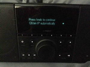 Picture of the Logitech Squeezebox Boom Radio, Displaying the Obtain IP Address Automatically Setting Screen.