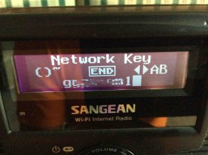 Picture of the Sangean WFR-20, displaying the Network Key screen, with a password entered. Note that the password characters have been blurred for security reasons.