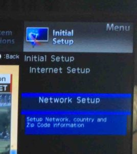 Picture of the Sharp Aquos TV, with the Network Setup menu item selected.