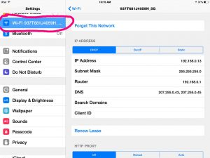 Picture of the iOS Settings Wi-Fi Page with Wi-Fi option selected and circled in pink.
