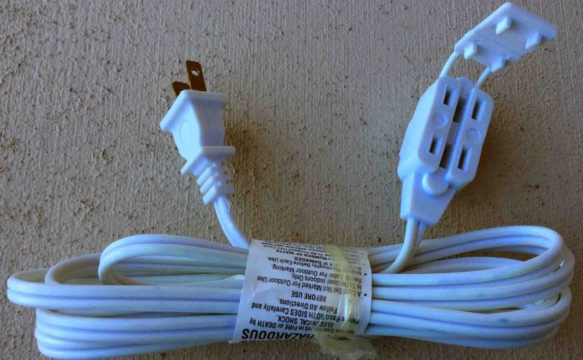 Picture of a Three outlet white extension cord, light duty indoor model.