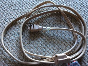 Extension cord safety tips: Picture of a heavy duty indoor single outlet extension cord.