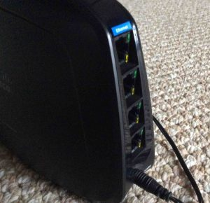Picture of the slanted back panel Ethernet ports on the Cisco Linksys WES610N Wireless Network Bridge.