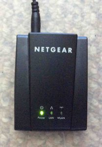 Picture of the Netgear WNCE2001 Universal Internet Adapter, boot up done but no WiFi connection established.