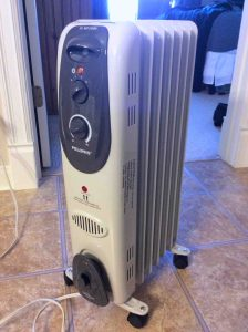 Picture of the Pelonis electric radiator heater HO-0250H, front view. Safest electric space heaters.
