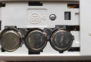 Picture of the open battery compartment of the Sharp El-620 Elsi Mate Talking Calculator, showing proper battery installation. The + sign should be visible on all three batteries.