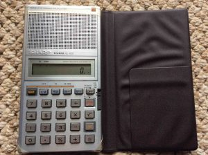 Picture of the Sharp EL-620 Elsi Mate Voice Synthesized Calculator, open case, front view.