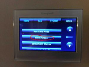 Reset Honeywell thermostat settings: Picture of the Honeywell RTH9580WF Smart Thermostat, showing the Menu Screen with Preferences button circled.