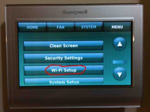 Picture of the Honeywell RTH9580WF WiFi Smart Thermostat menu, with the WiFi Setup button circled.