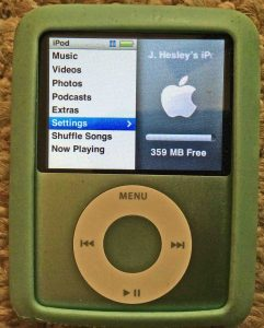 Picture of the iPod Nano 3rd Gen Portable Player, displaying its main menu, with the settings item selected. Restore iPod Nano 3rd generation.
