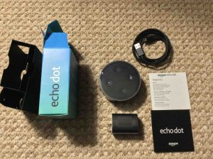 Picture of the Amazon Echo Dot 2nd Gen speaker, original package, with Items inside unpacked. Amazon Alexa Echo Dot speaker picture gallery.