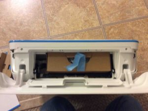 Picture of the HP DeskJet 3632 printer with inner access panel open, showing box with cords inside.