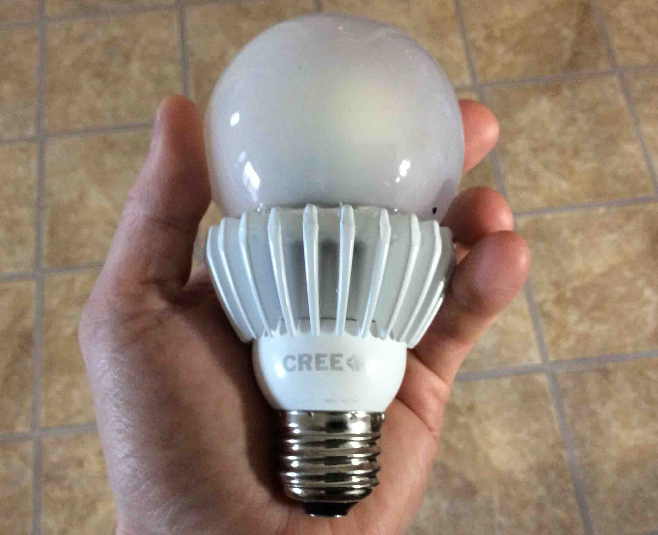 Cree 100w led soft white 2700k dimmable light bulb review toms picture of the cree 100w led dimmable a21 light bulb held in hand arubaitofo Image collections