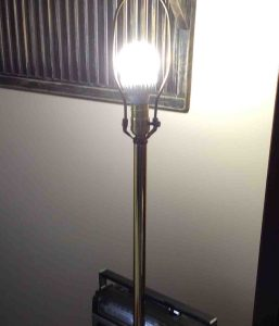 Picture of this A21 bulb, operating In living room lamp, with the shade removed.