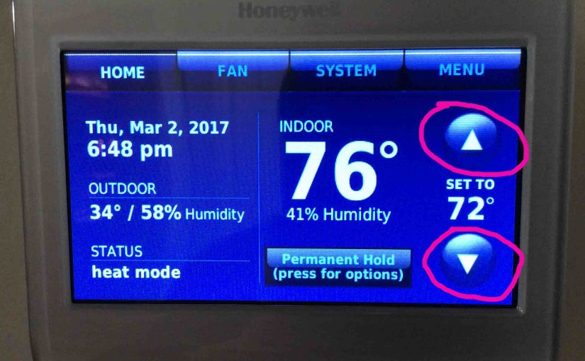 Picture of the Honeywell RTH9580WF smart thermostat, now locked, displaying Its -Home- screen.