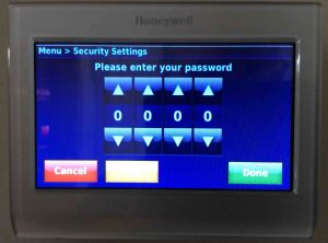 Picture of the Honeywell RTH9580WF smart thermostat, displaying its -Please Enter Your Password- screen, with no passcode entered yet.