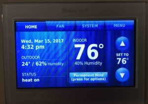 Picture of the Honeywell RTH9580WF thermostat, showing its -Home- screen, after new temperature offset applied.