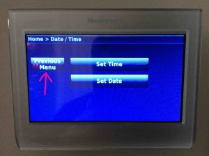 Picture of the Honeywell RTH9580WF Wi-Fi thermostat, displaying its -Date/Time- screen, with the -Done- button highlighted.
