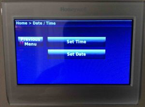 Picture of the Honeywell RTH9580WF Wi-Fi thermostat, displaying its -Date/Time- screen.
