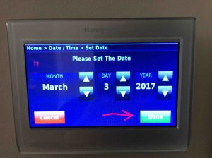 Picture of the Honeywell RTH9580WF Wi-Fi thermostat, displaying the -Set Date- screen, with the -Done- button highlighted.
