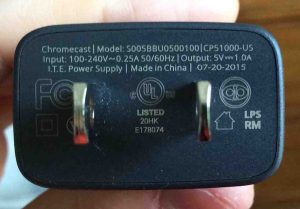 Picture of the Google Chromecast Audio Receiver power adapter, rear AC end, showing supply specs.