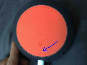 Picture of the Google Home Mini speaker, bottom view, showing the reset button highlighted. Google Mini reset button.